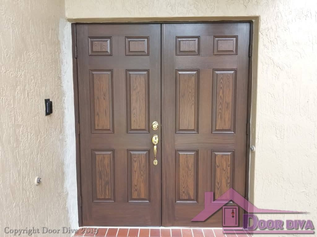 Double entry doors painted in a wood grain finish