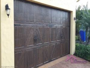 Garage doors painted in a wood grain finish